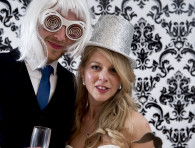 bride and groom with wigs, hat and funny glasses - wedding photo booth at villa eva, ravello