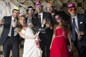 wedding photo booth - group of guests with funny glasses and hats